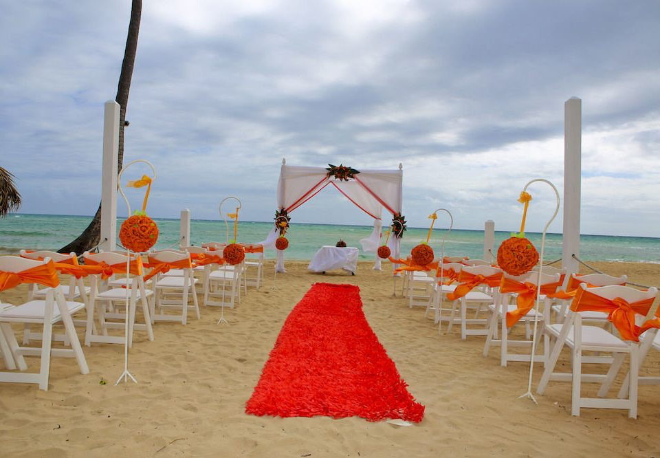 sky chair Beach aisle ceremony wedding flower sandy