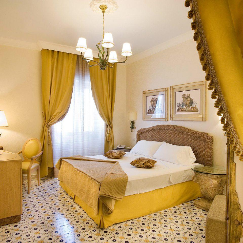Beach Beachfront Bedroom Classic Historic Honeymoon Island Resort Romance Romantic yellow property Suite cottage