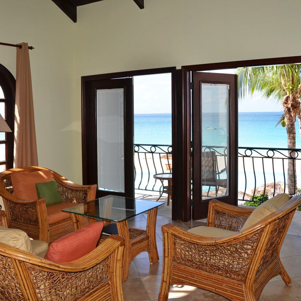 Beach Beachfront Exterior Lounge Ocean chair property living room Villa house home cottage Suite farmhouse mansion Resort hacienda Bedroom