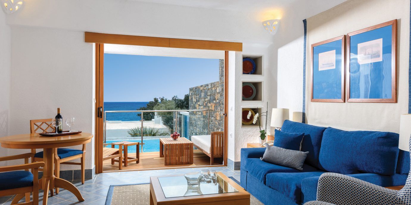 Beach Beachfront Family Modern Scenic views Suite property living room home Villa cottage condominium blue Bedroom