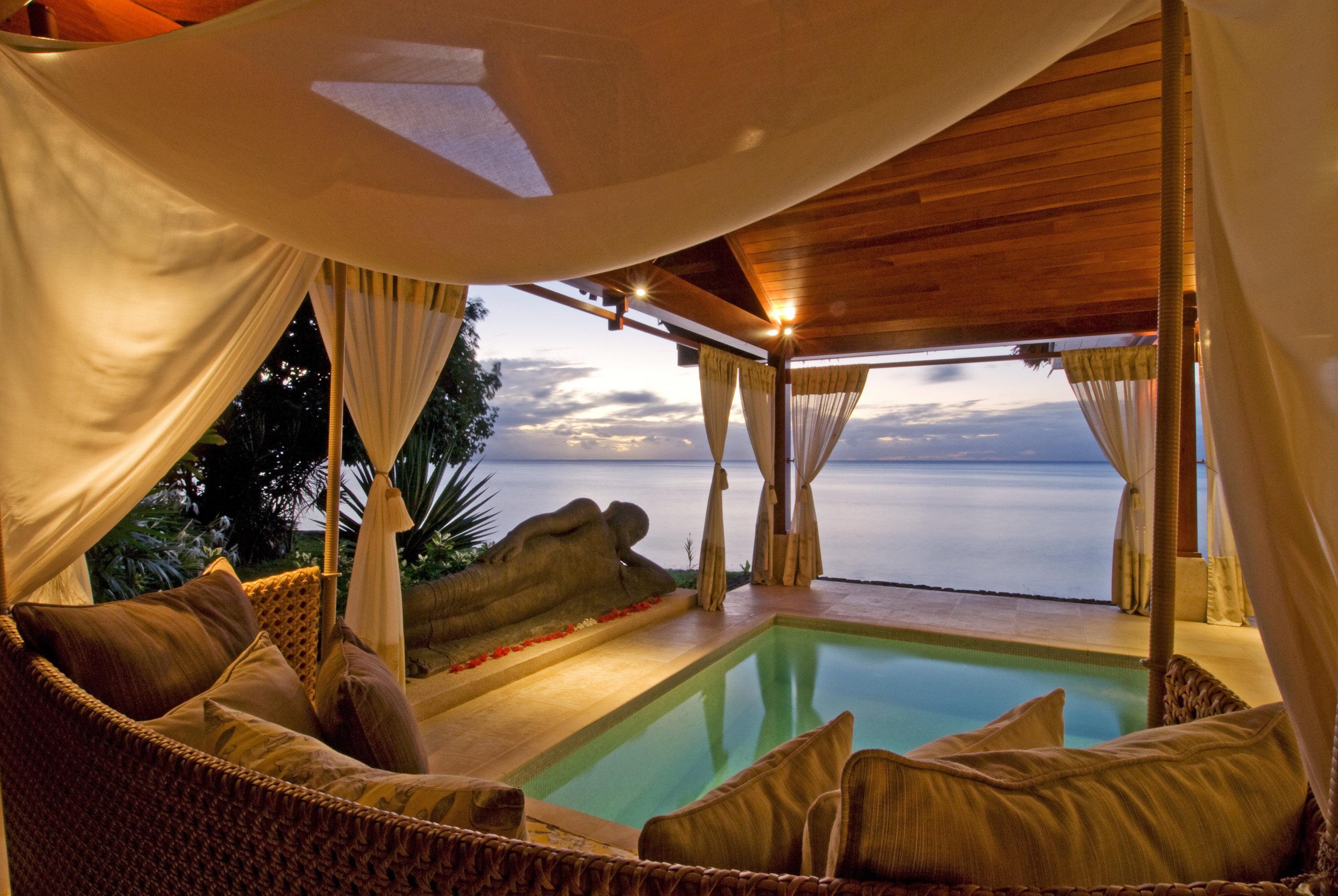 Beach Beachfront Honeymoon Luxury Romance leisure chair Resort swimming pool Villa Suite Bedroom