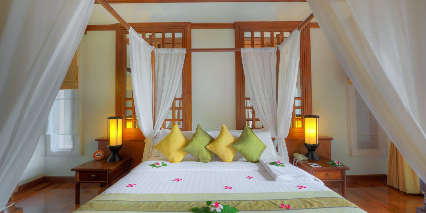 Beach Beachfront Bedroom Honeymoon Romance Romantic Tropical Waterfront property curtain cottage Suite Resort Villa