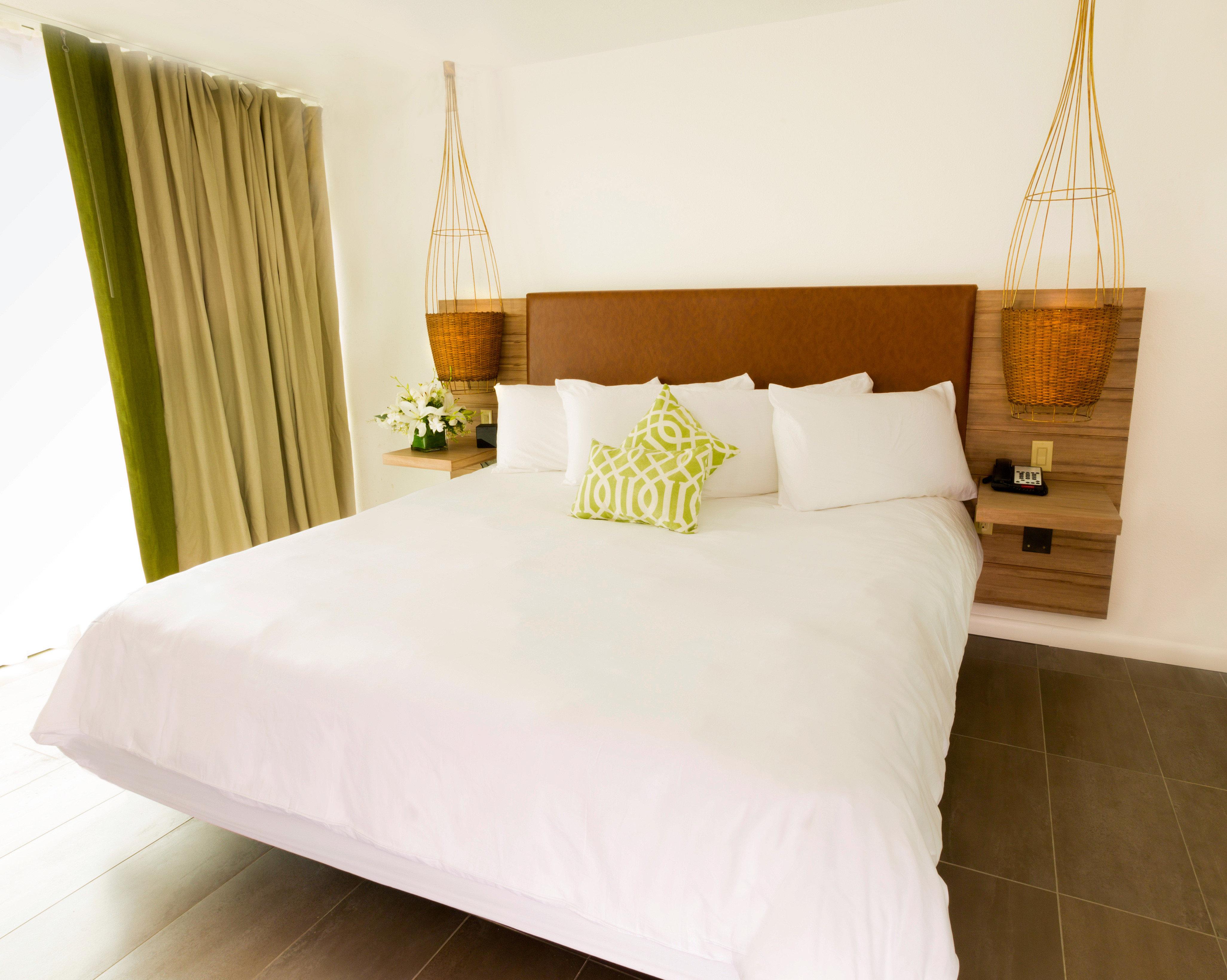Beach Beachfront Bedroom Resort property Suite bed sheet white bed frame cottage duvet cover