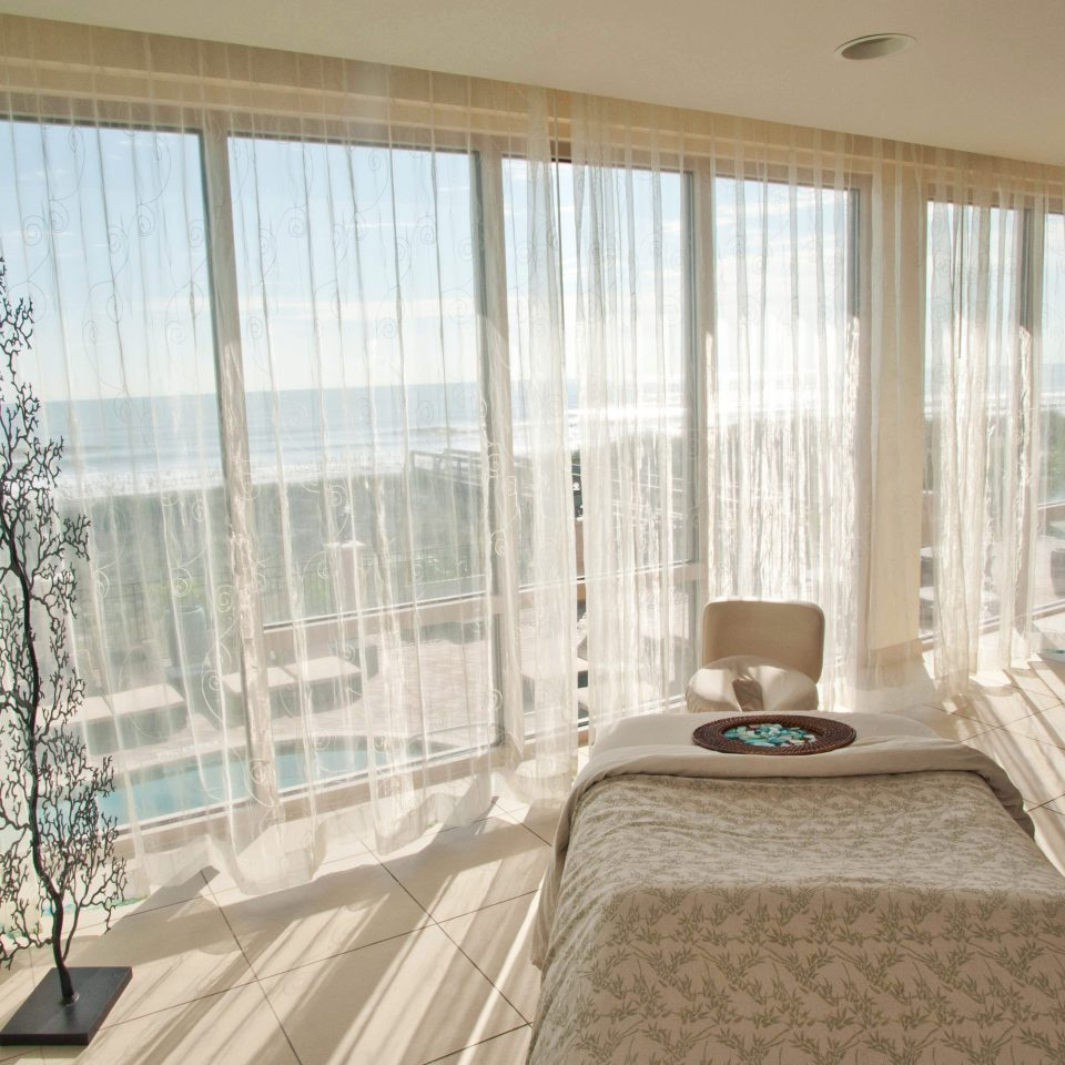 Beach Beachfront Resort Spa property curtain Bedroom window treatment textile living room Suite tub