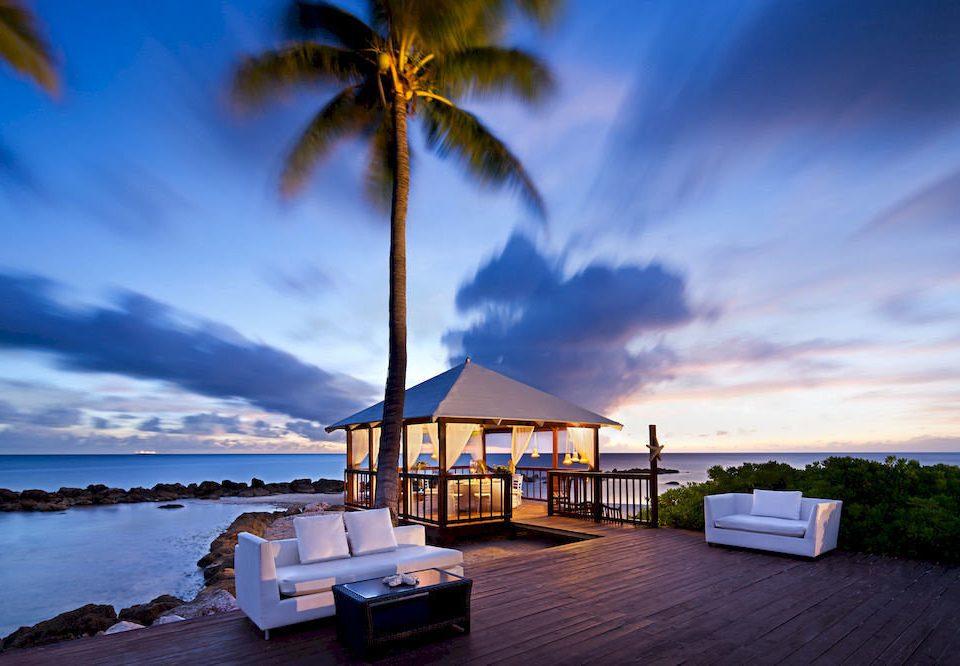 Beach Beachfront Boat Luxury Ocean Tropical sky Sea horizon Sunset shore cloud Coast caribbean morning arecales dusk evening sunlight Island