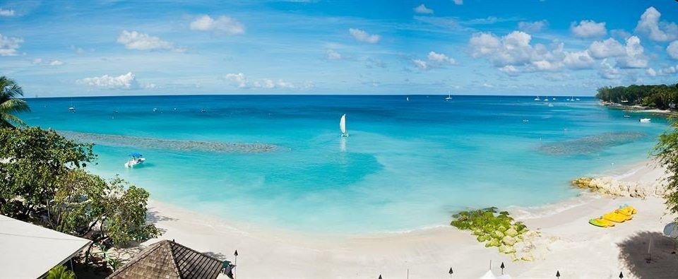 Beach Beachfront Boat Ocean Outdoor Activities Romantic water sky Nature caribbean Coast Sea shore islet Lagoon Island cape cove terrain tropics blue overlooking swimming clouds sandy