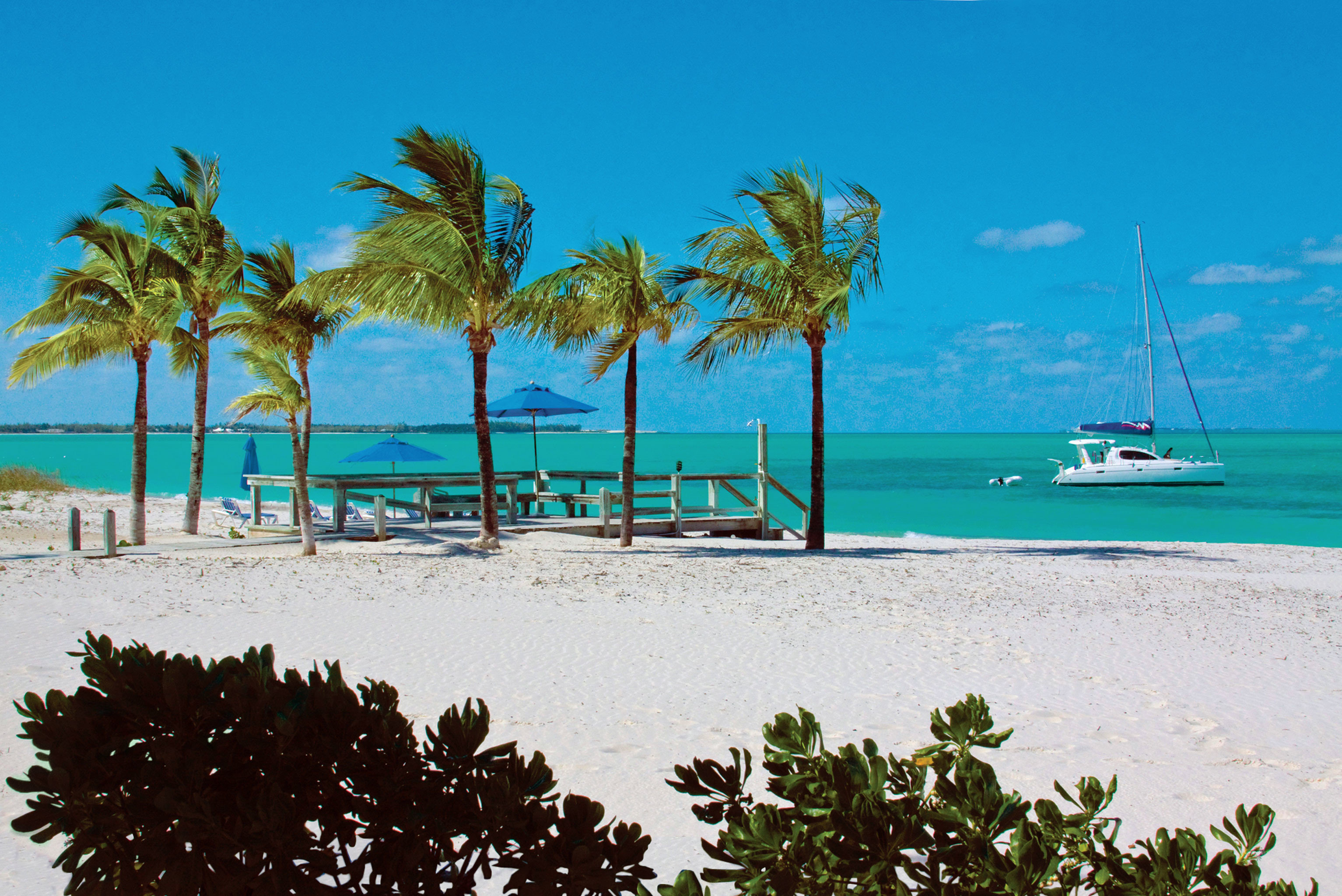 Beach Beachfront Boat Grounds Play Resort tree sky water shore palm Sea caribbean Ocean Coast tropics arecales Lagoon palm family Island cape cay sandy