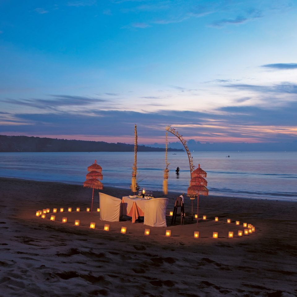 Beach Beachfront Luxury Romantic sky water Sea Boat horizon Ocean shore Coast cloud Sunset dusk evening sunrise dawn tower ship morning wave vehicle sand cape pier distance