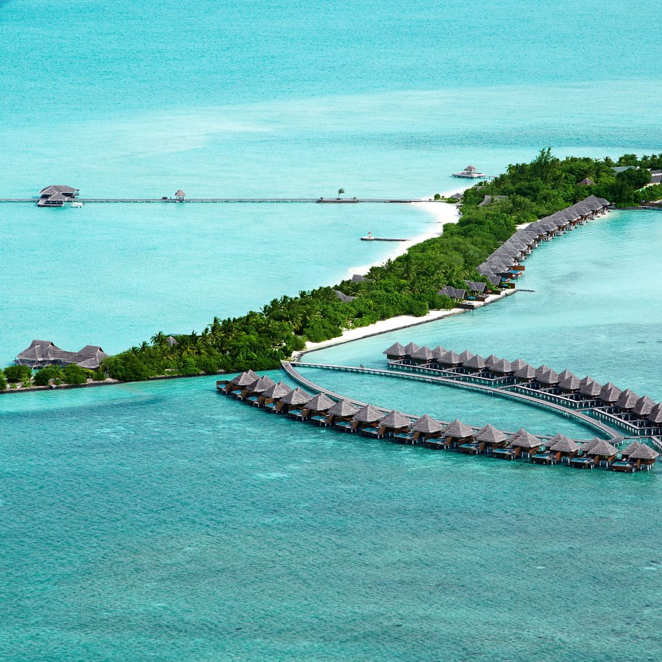 Beachfront Grounds Outdoors Resort Scenic views water Boat Sea archipelago Coast islet Ocean Island shore caribbean Beach atoll cape vehicle wave Lagoon cay aerial photography tropics
