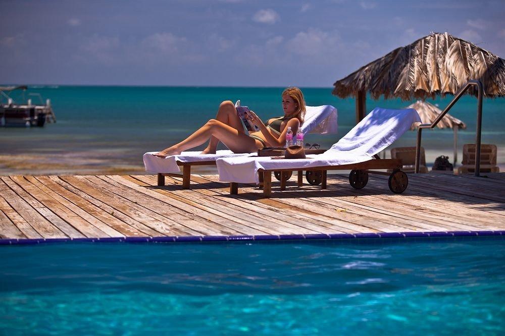 Beach Beachfront Ocean Resort Scenic views water sky leisure swimming pool Sea wooden caribbean Coast dock blue shore Deck swimming Boat