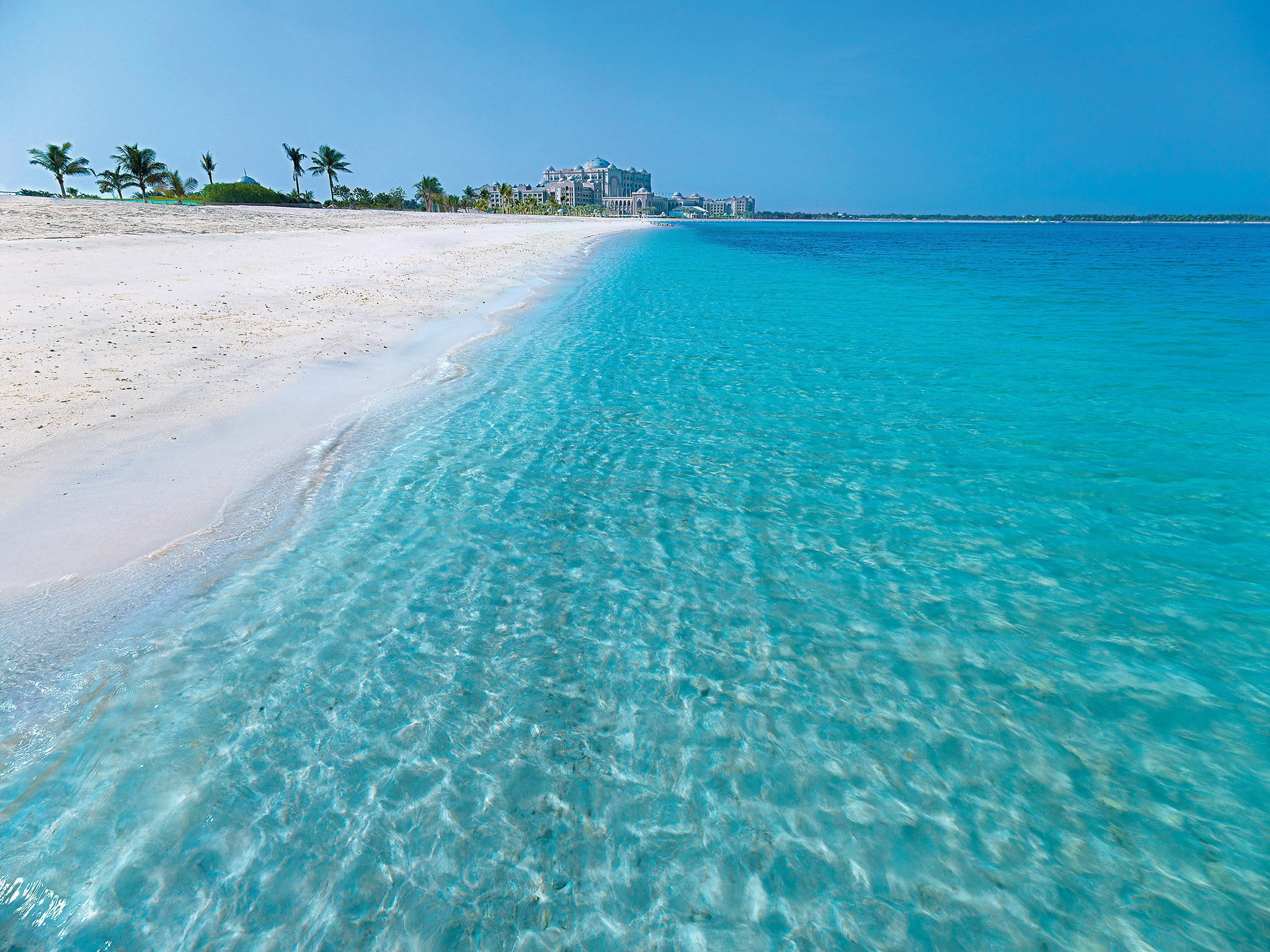 Beachfront Boat Ocean water sky Beach Sea Nature shore caribbean wind wave horizon Coast wave Lagoon atoll cape Island cay islet blue swimming clear day sandy
