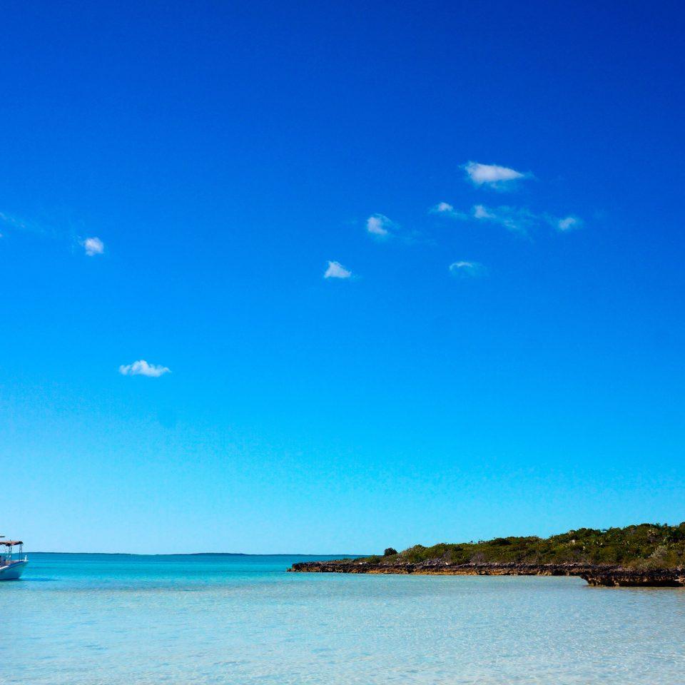 Beach Beachfront Honeymoon Hotels Romance sky water Boat Sea horizon shore Ocean blue cloud Coast Lake dusk Island islet Lagoon distance