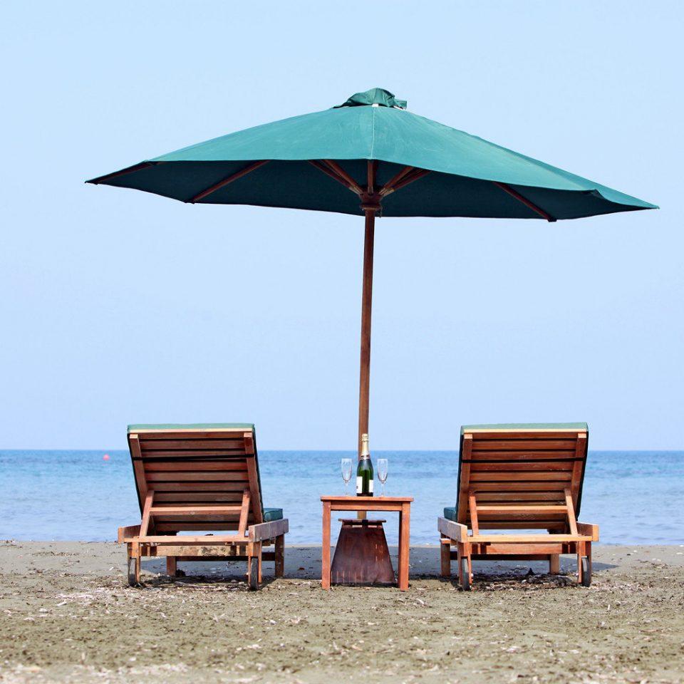 Beach Beachfront Lounge Ocean Romantic sky chair umbrella water Sea shore fashion accessory Nature Coast lawn accessory Boat shade