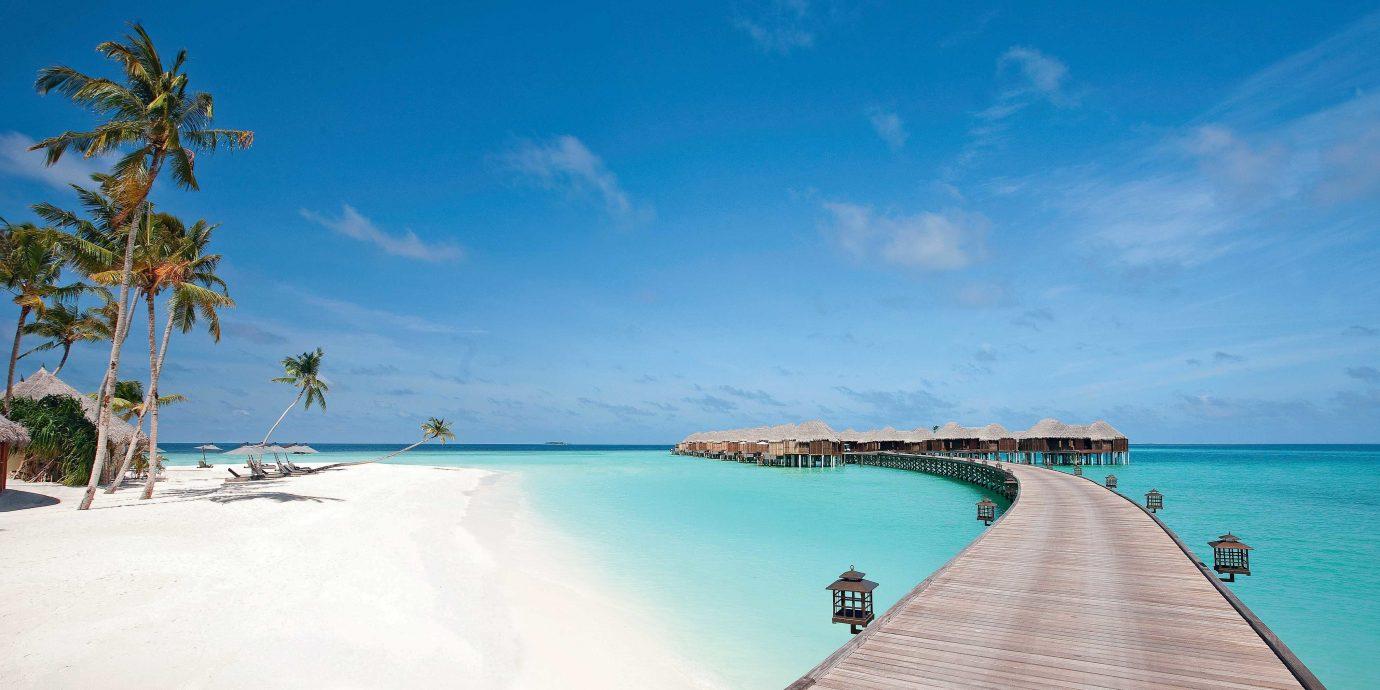 Beach Beachfront Ocean water sky Boat Sea caribbean Nature shore Coast Island Resort Lagoon cape atoll islet cay tropics swimming
