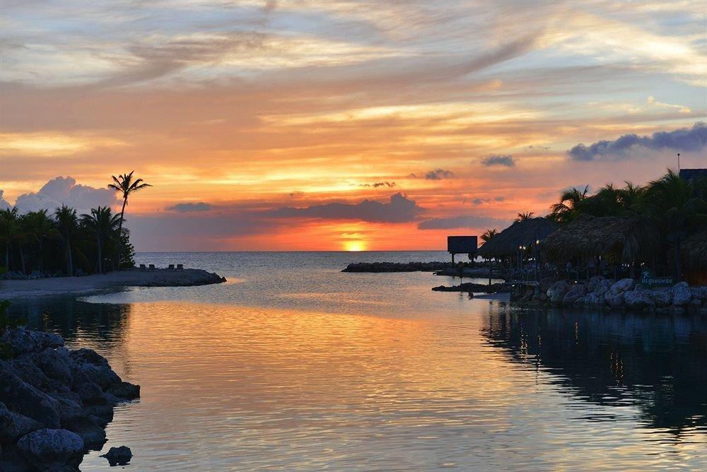 Beach Beachfront Luxury Ocean water sky Boat Sunset sunrise shore Sea dawn cloud Lake horizon dusk afterglow scene morning evening Coast River traveling loch surrounded Island
