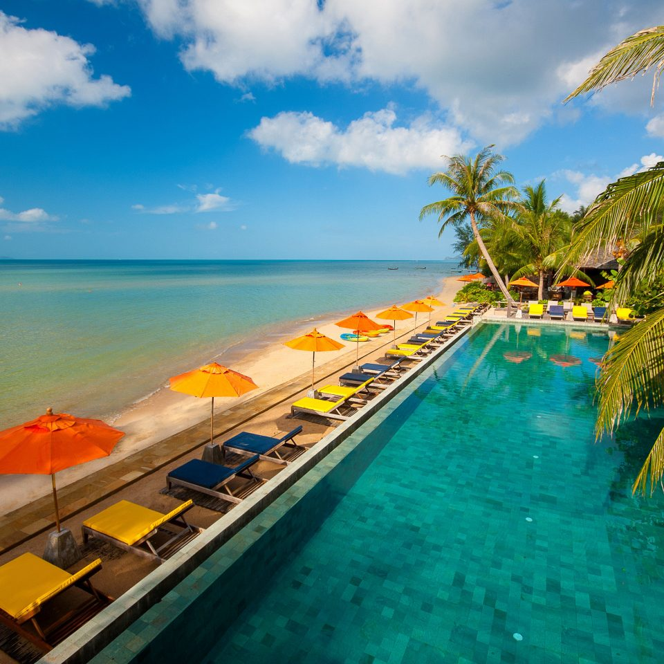 Beachfront Jungle Lounge Ocean Outdoors Patio Pool Tropical Waterfront sky water Sea Beach caribbean Boat Coast tropics arecales Island Lagoon cape swimming pool lined shore