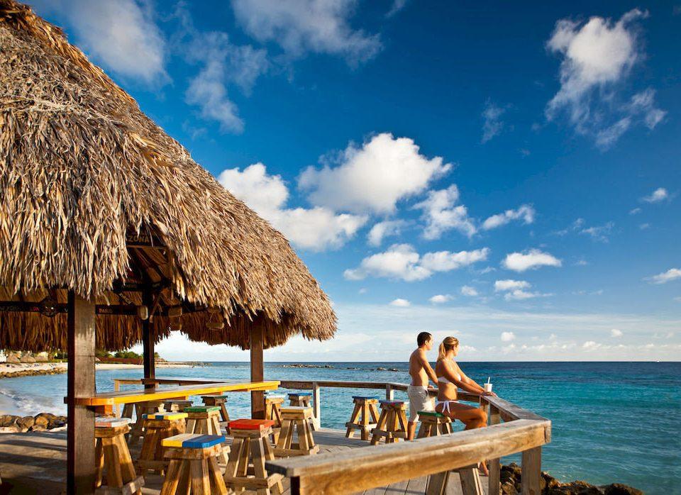 Beach Beachfront Boat Luxury Ocean Tropical sky water umbrella Sea caribbean Resort Coast Island hut day sandy
