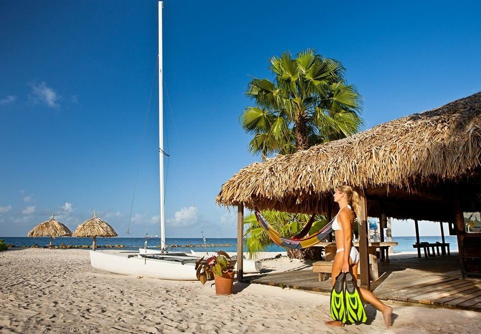 Beach Beachfront Boat Luxury Ocean Tropical sky ground Sea caribbean Coast arecales Resort tropics Island cape sand travel shore sandy day