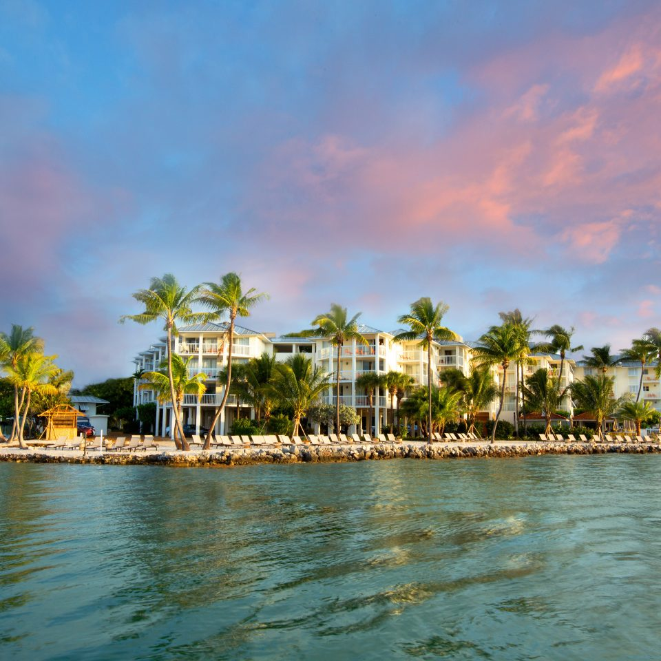 Beach Beachfront Resort Scenic views water sky Boat shore Sea scene Ocean Harbor dusk arecales evening marina Lagoon dock Coast caribbean tropics docked surrounded