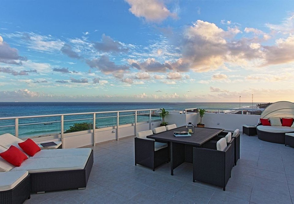 Beach Beachfront Deck Lounge sky ground property Sea Ocean vehicle passenger ship caribbean dock yacht marina Boat shore day