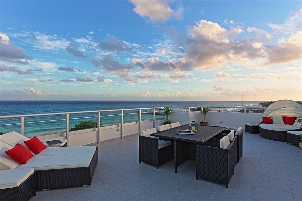 Beach Beachfront Deck Lounge sky ground property Sea Ocean vehicle passenger ship caribbean dock yacht marina Boat shore day