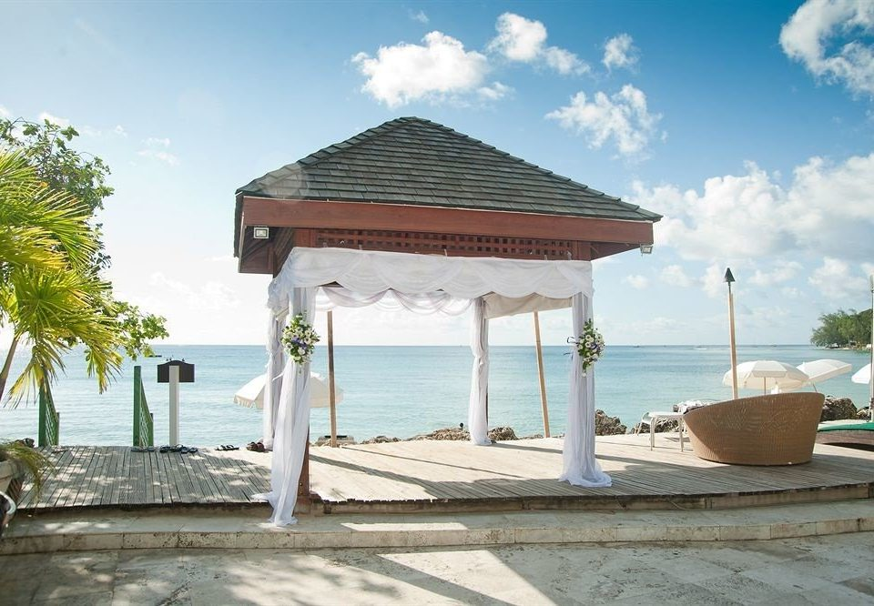 Beach Beachfront Boat Ocean Outdoor Activities Romantic sky ground property building Villa Resort outdoor structure pavilion hacienda gazebo mansion porch Deck shore day