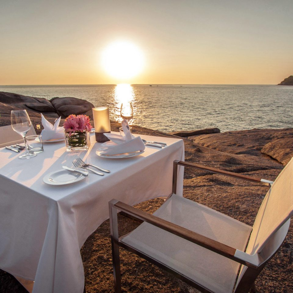 Beach Beachfront Dining Drink Eat Hip Luxury Modern Scenic views sky water vehicle yacht Boat restaurant set shore