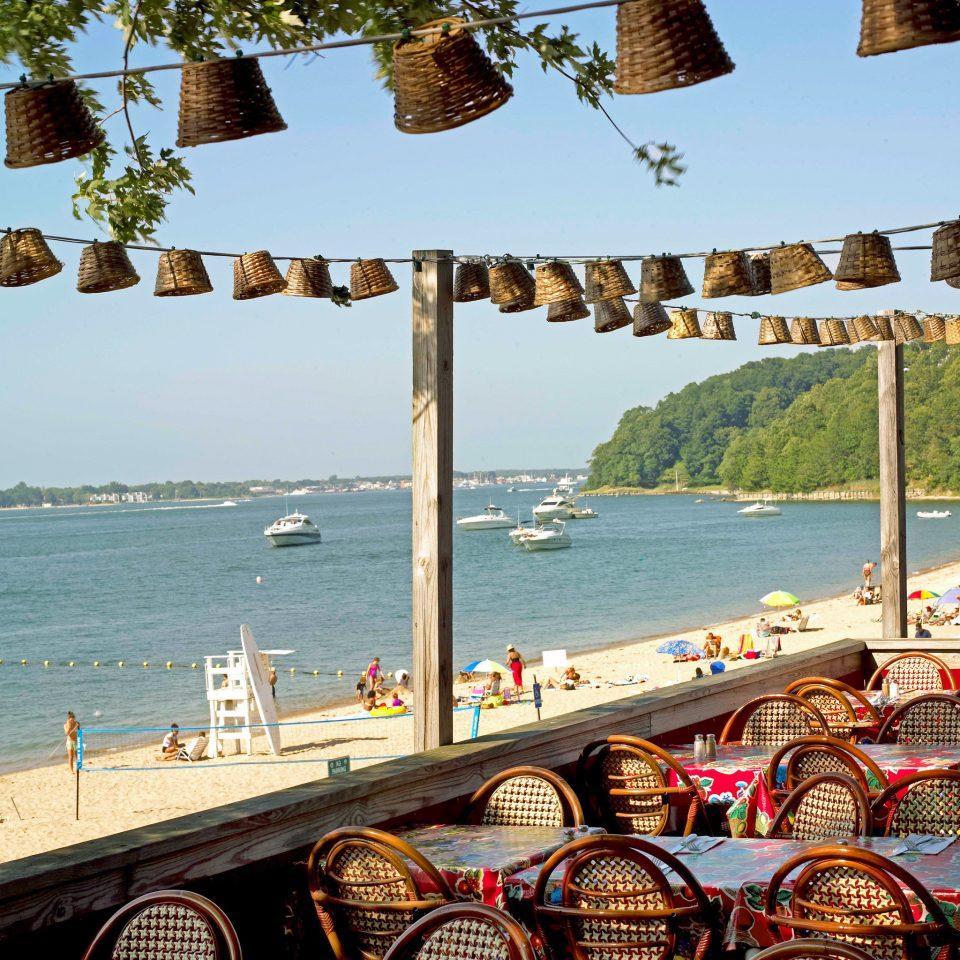 Beach Beachfront Boat Drink Eat Lounge Outdoor Activities Patio Terrace sky leisure walkway Sea boardwalk Resort travel restaurant