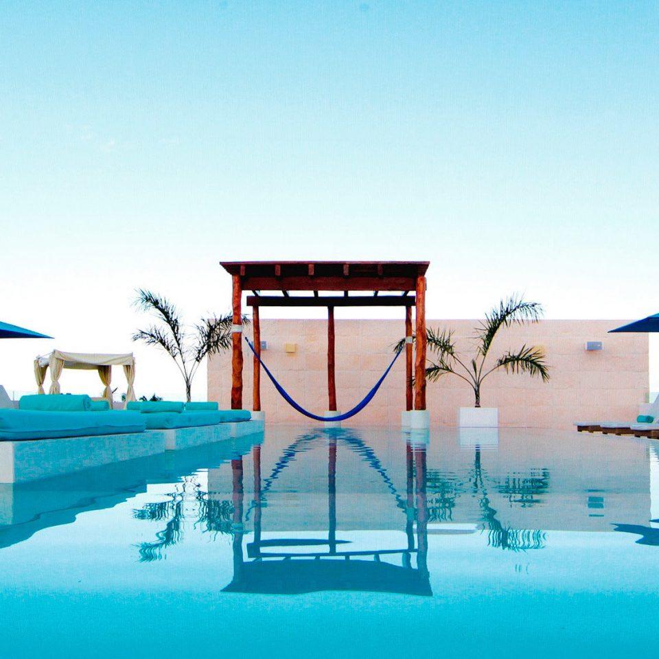 Beachfront Elegant Hip Lounge Luxury Modern Pool sky leisure swimming pool blue Resort Beach dock marina Sea Water park amusement park airplane aircraft Boat day