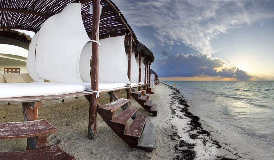 Beach Beachfront Exterior Lounge Luxury Ocean water ground Boat vehicle Sea sandy