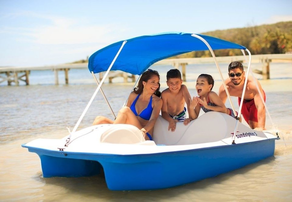 Beach Beachfront Boat Family Play Resort Scenic views sky accessory water umbrella leisure vehicle dinghy sailing watercraft watercraft rowing dinghy sailing sail sailboat blue skiff boating day