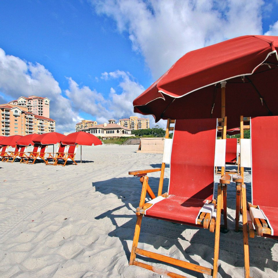Beach Beachfront Inn Lounge Resort Waterfront sky umbrella chair leisure red orange Sea Boat day