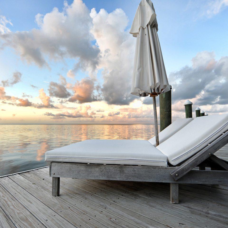 Beach Beachfront Island Outdoors Resort Romance Romantic Scenic views Waterfront sky ground vehicle Boat Sea wooden dock