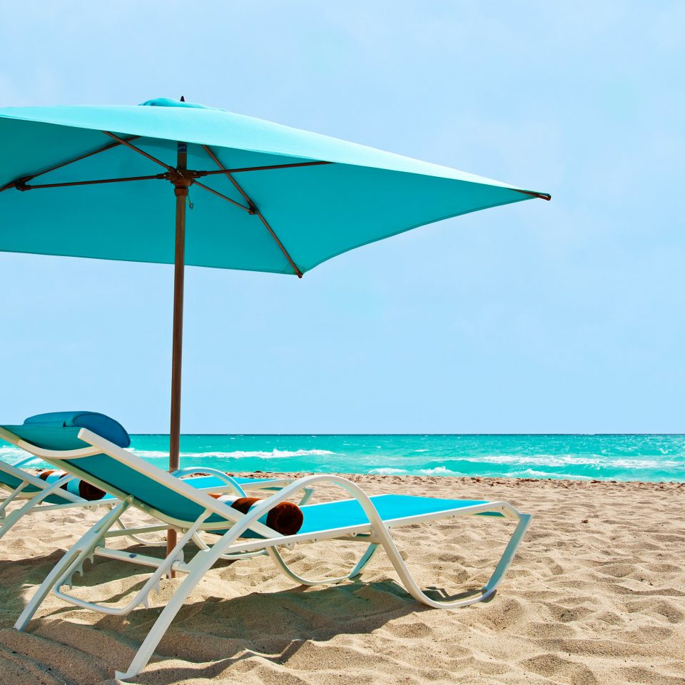 Beach Beachfront Lounge Luxury Ocean sky accessory ground umbrella leisure chair fashion accessory Nature Sea shore wind blue Boat day