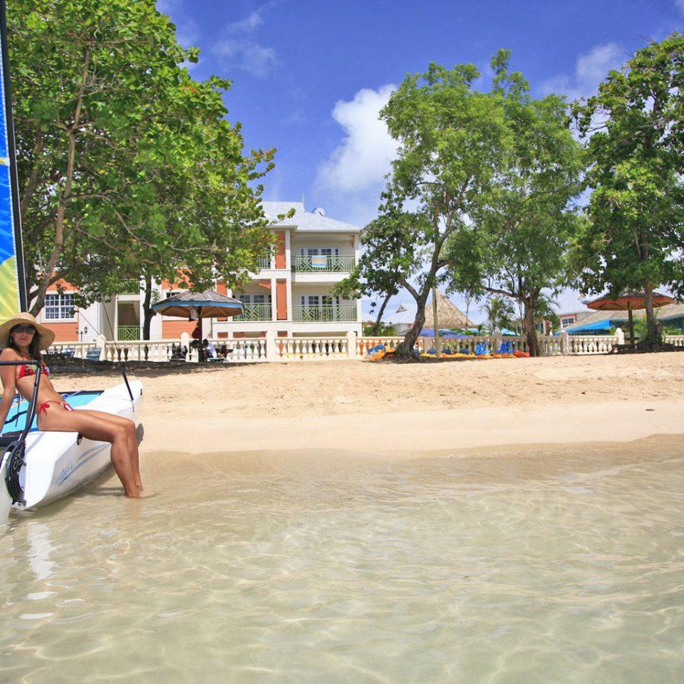 Beach Beachfront Lounge Ocean tree leisure water watercraft walkway swimming pool Sea Water park boardwalk Resort dock Boat