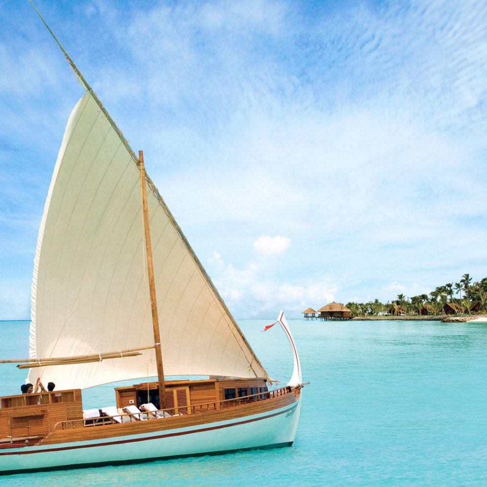 Beach Beachfront Luxury Outdoor Activities Romance Romantic Tropical Wellness water Boat sky watercraft transport sailboat vehicle Sea sail ship sailing vessel Ocean sailing ship caribbean sailing yacht schooner mast