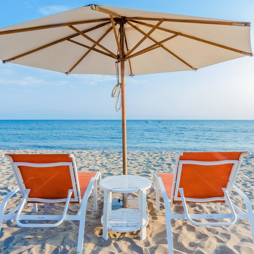 Beach Beachfront sky water chair umbrella lawn Nature Sea shore accessory Resort cottage caribbean orange set empty Boat day