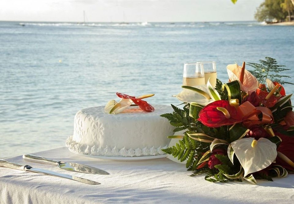 Beach Beachfront Boat Ocean Outdoor Activities Romantic water wedding cake flower food