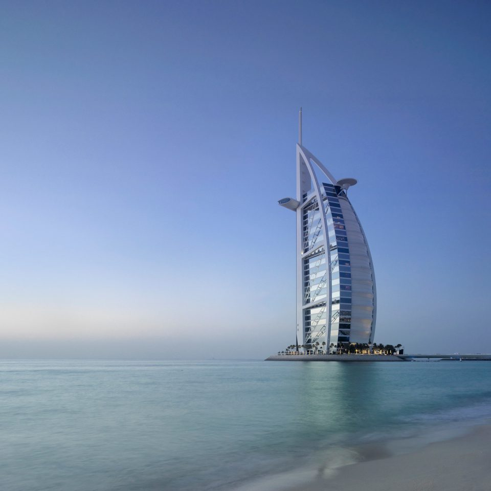 Beach Beachfront Boat Ocean sky water Sea vehicle sail tower horizon sailing ship sailboat sailing mast wind shore