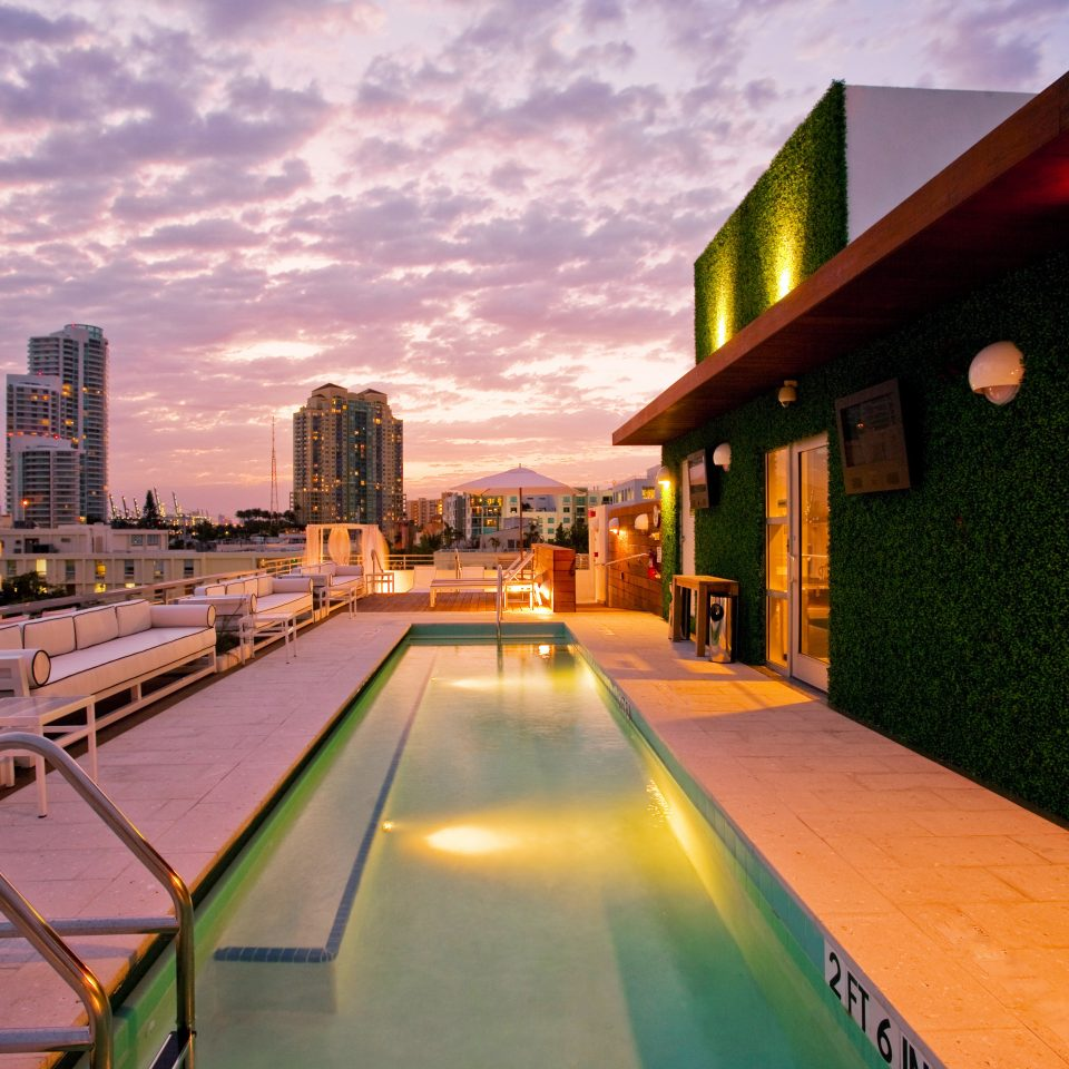 Beach Beachfront Boutique Drink Pool sky City Town night evening Downtown cityscape dusk Sunset way road