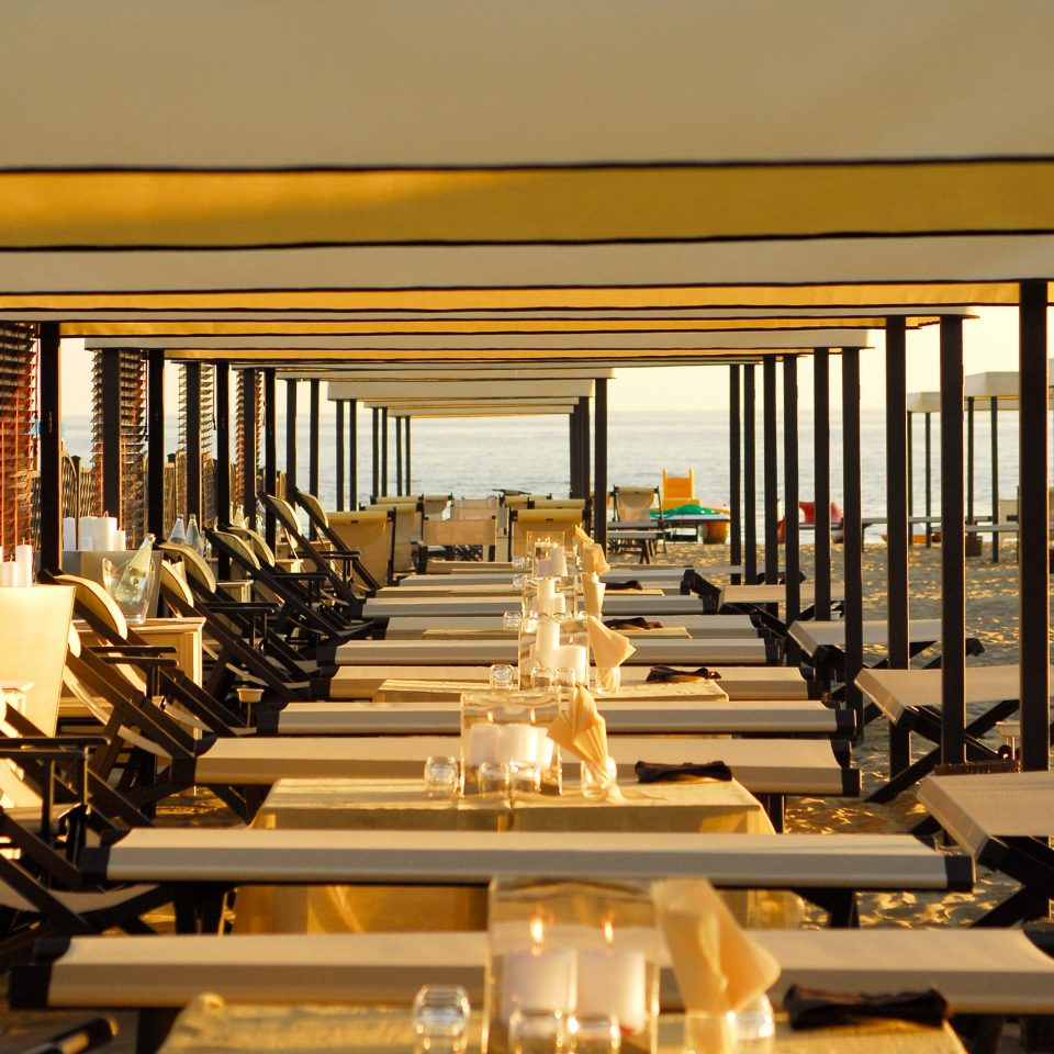 Beach Beachfront Boutique Classic Dining Drink Eat chair row restaurant lined Resort home function hall Lobby condominium convention center overlooking line