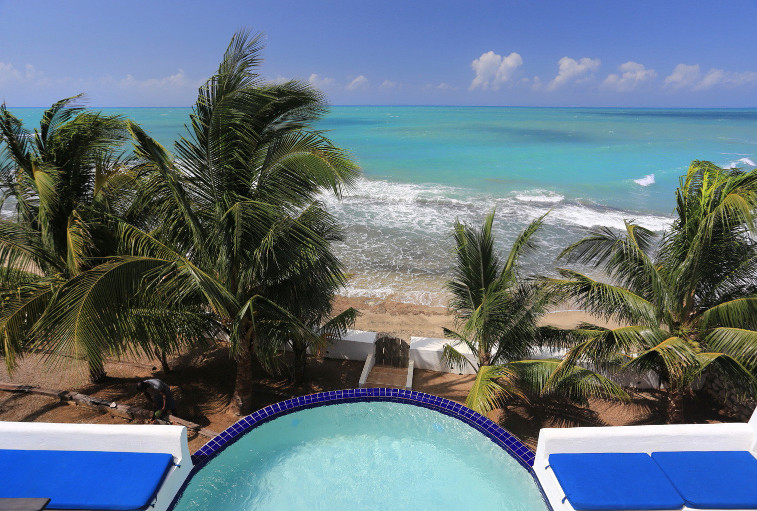 Beachfront Boutique Pool Romantic Rustic Tropical tree sky swimming pool leisure Beach caribbean property Resort Ocean Sea tropics arecales Lagoon blue Coast cape lawn Villa Island outdoor object