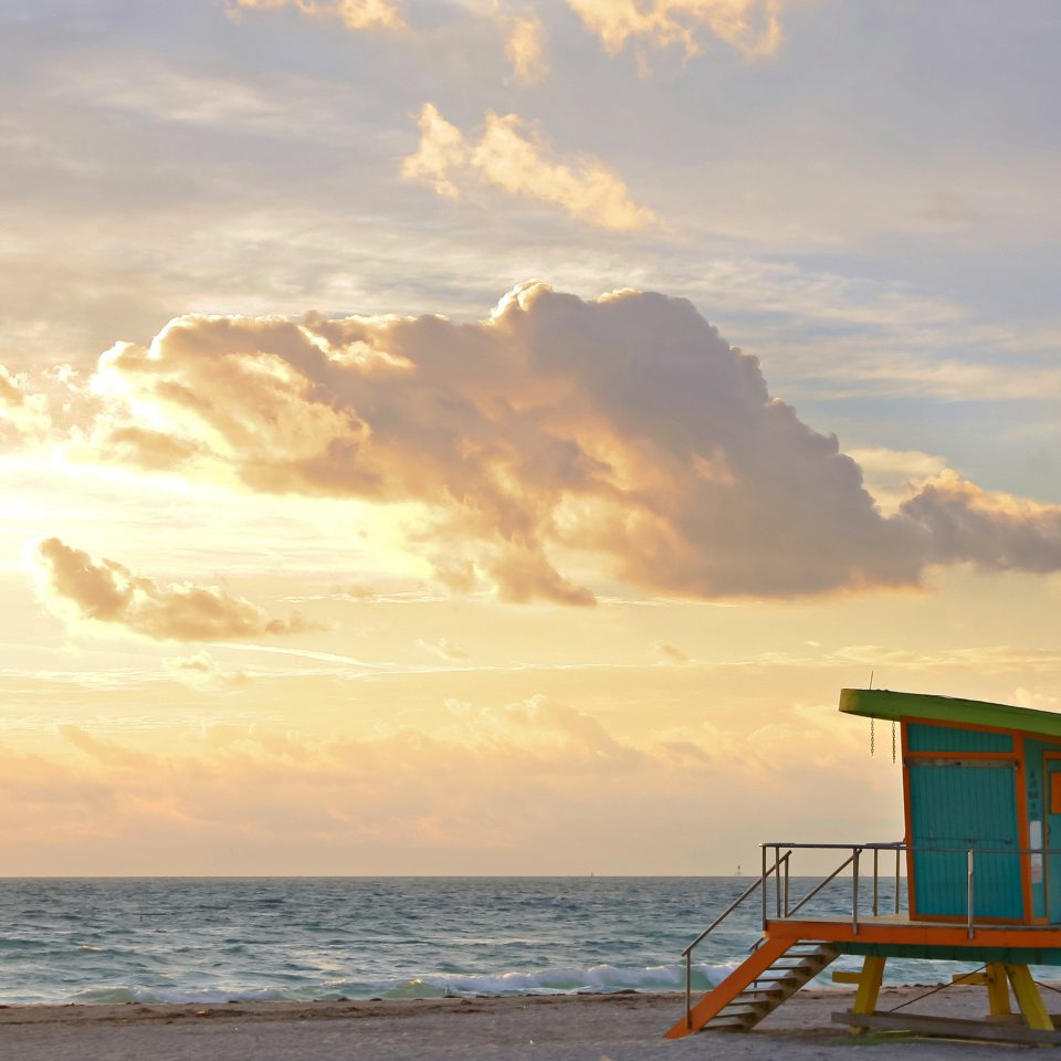 Beach Beachfront Boutique Drink sky water Sea shore Ocean horizon cloud Coast Sunset morning sunrise sunlight evening Nature dusk wave dawn sand clouds sandy