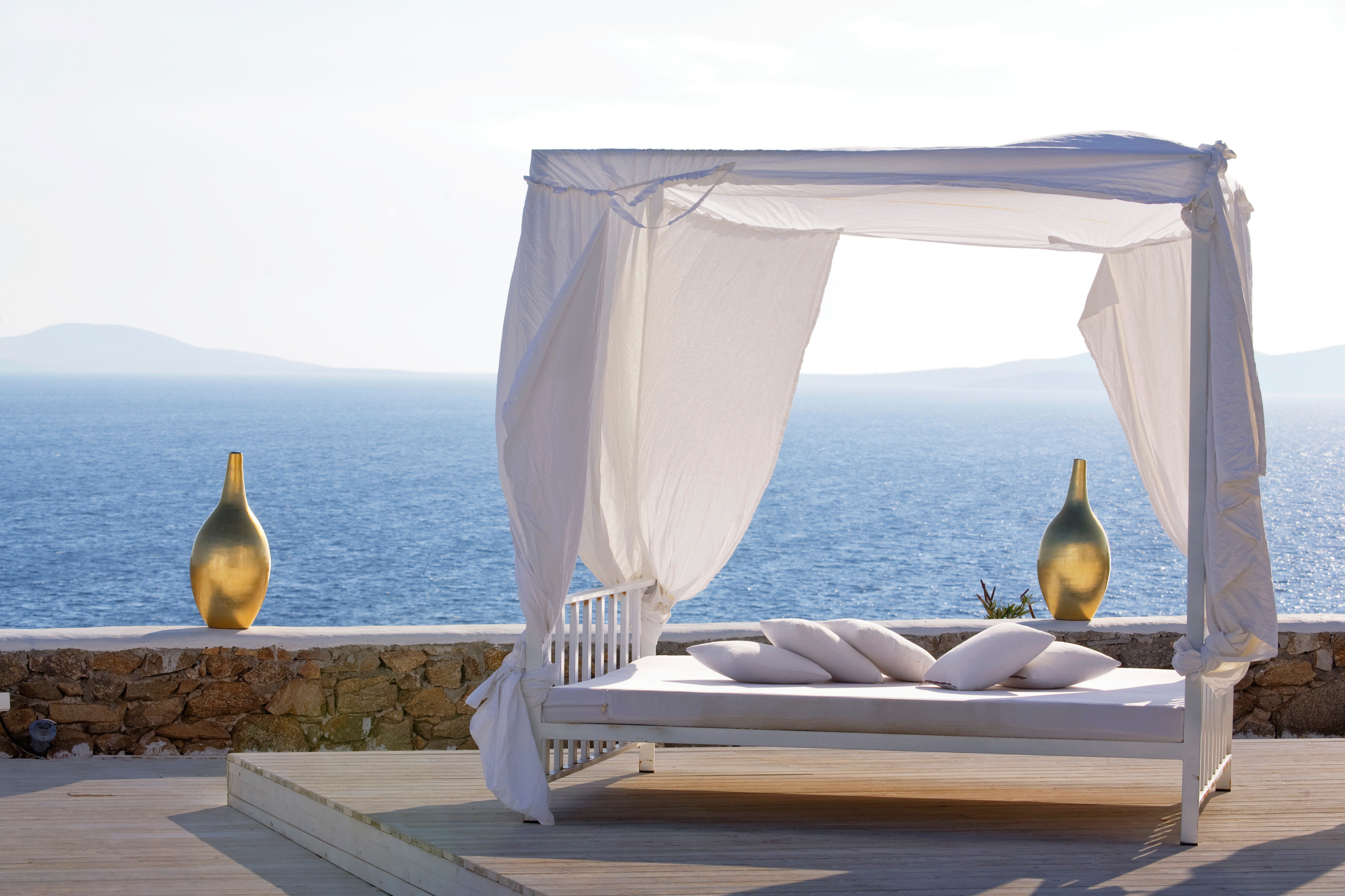 Beach Beachfront Boutique Deck Hotels Luxury Romance Scenic views Trip Ideas sky water studio couch overlooking