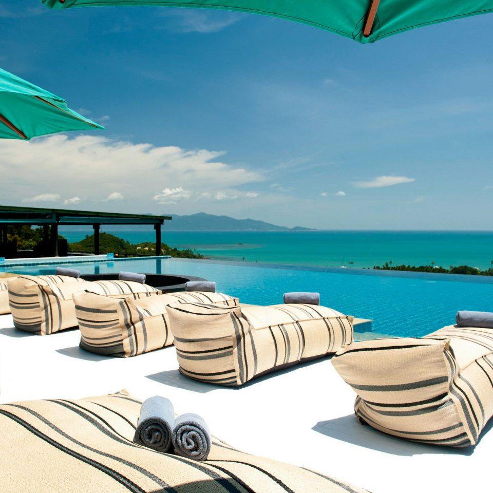 Beachfront Boutique Deck Pool Scenic views sky umbrella leisure caribbean accessory Sea Ocean Resort Beach vehicle day sandy
