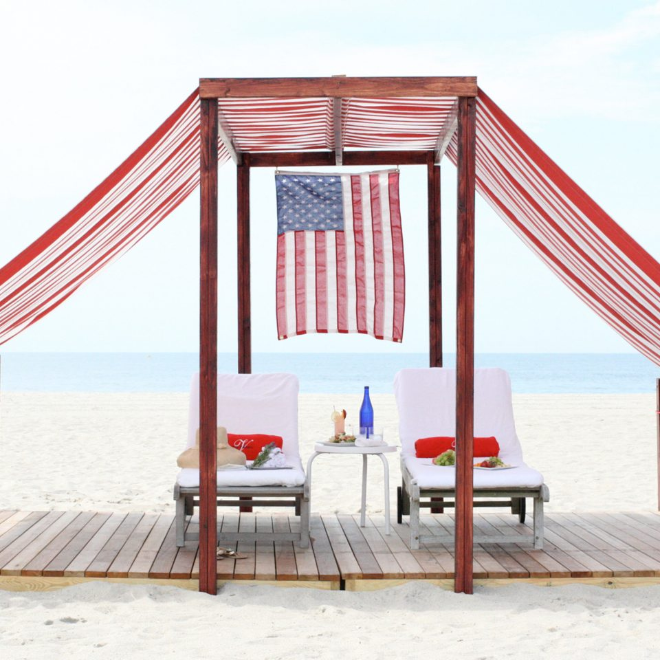 Beach Beachfront Boutique Deck Lounge Ocean Patio Trip Ideas Waterfront Weekend Getaways sky chair tent canopy Play outdoor play equipment day sandy