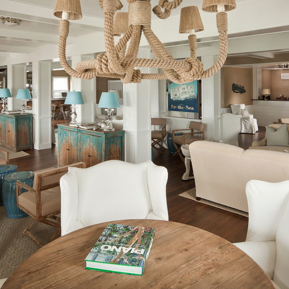Beach Beachfront Boutique Dining Drink Eat sofa property living room home Suite cottage
