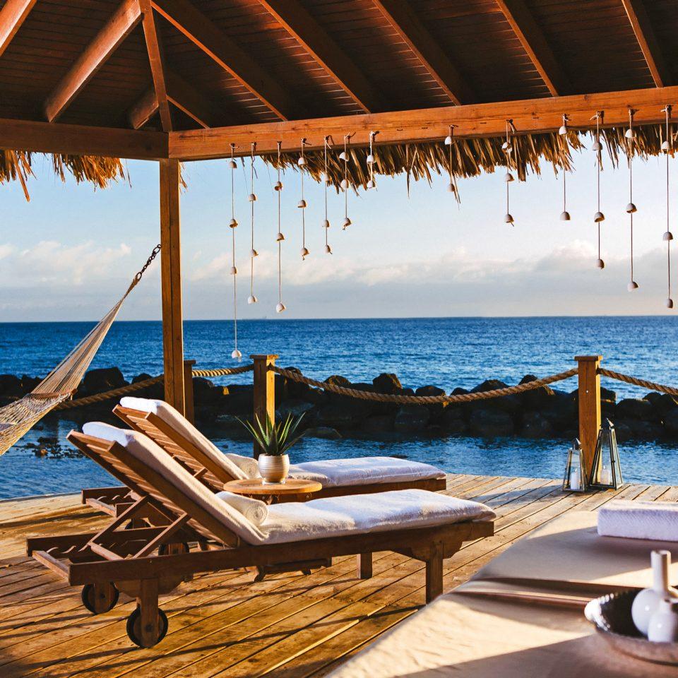 Beach Beachfront Budget Deck Hotels leisure swimming pool Resort Sea caribbean Villa