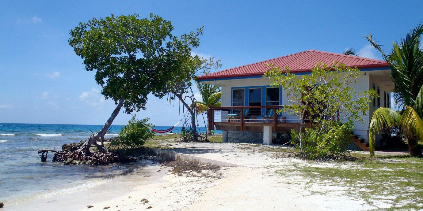Beach Beachfront Budget Exterior Family Island Tropical sky property Resort Nature caribbean Sea shore sandy
