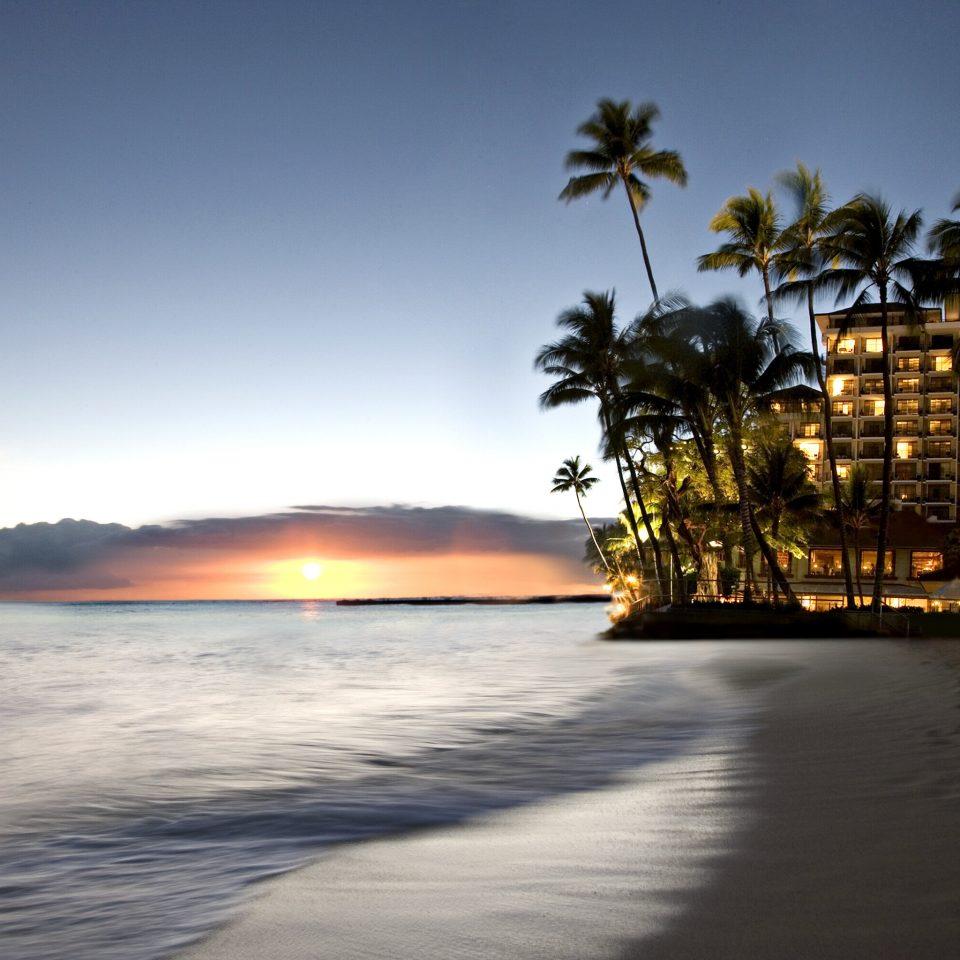 Beach Beachfront Buildings Exterior Luxury Ocean Resort Scenic views Sunset sky water shore Sea horizon morning evening dusk Coast sunlight sunrise dawn vehicle wave